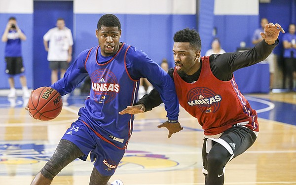 Blue Team guard Malik Newman drives to the bucket against Red Team guard Keith Langford during a scrimmage on Wednesday, June 7, 2017 at the Horejsi Family Athletics Center.