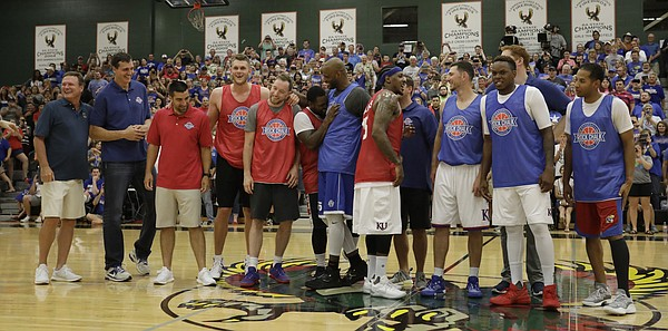 Members of the 2008 championship team gather at half court during the 2017 Rock Chalk Roundball Classic Thursday evening at Lawrence Free State High School. The annual charity event benefits local families fighting cancer