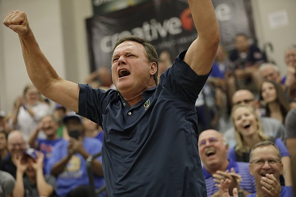 Kansas coach Bill Self, jumps up from the stands to cheer after his son Tyler hit a 3-point basket during the 2017 Rock Chalk Roundball Classic Thursday evening at Lawrence Free State High School. The annual charity event benefits local families fighting cancer.