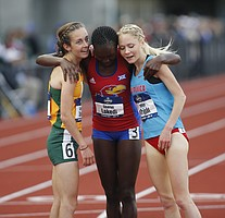 San Francisco's Charlotte Taylor, left, Kansas' Sharon Lokedi, center, and New Mexico's Alice Wright, right, embrace after finishing the women's 10,000 meters on the second day of the NCAA outdoor college track and field championships in Eugene, Ore., Thursday, June 8, 2017. Taylor won the race in 32 minutes, 38.57 seconds. (AP Photo/Timothy J. Gonzalez)