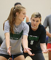 Free State volleyball coach Keely Hammontree works on positioning with sophomore Haylee Kern during volleyball camp on Monday, June 12, 2017.