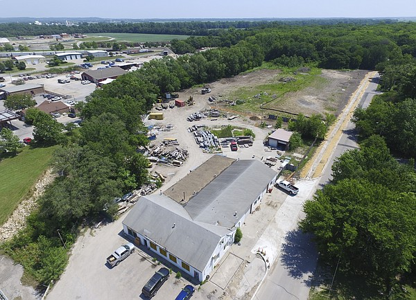 Owners of the Struct/Restruct property at 1146 Haskell Ave., which was once occupied by the 12th and Haskell Recycling Center, have sold for $58,000 a lot that contains one of the largest bur oak trees in the state.