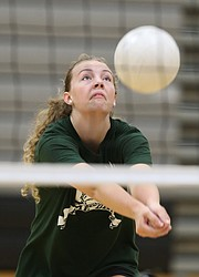 Free State junior Rachel Hickman hustles for a ball during volleyball camp on Monday, June 12, 2017.