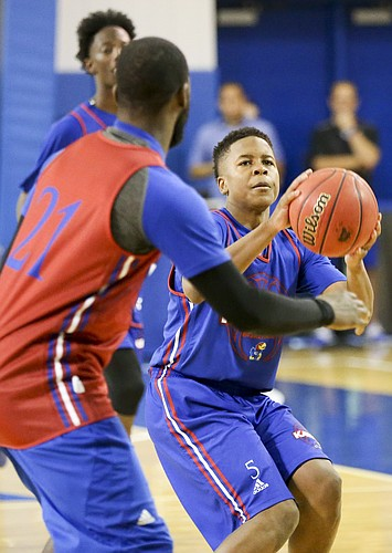 Kansas sophomore point guard Charlie Moore pulls up for a shot during a scrimmage on Wednesday, June 7, 2017 at the Horejsi Family Athletics Center.