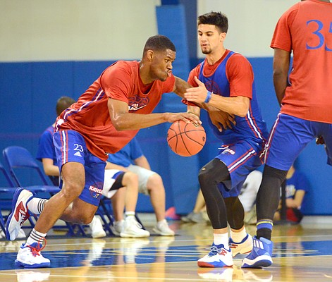 Kansas freshman forward Billy Preston drives toward the paint during a camp scrimmage at Horejsi Family Athletics Center on Wednesday, June 14, 2017, as sophomore Sam Cunliffe defends.