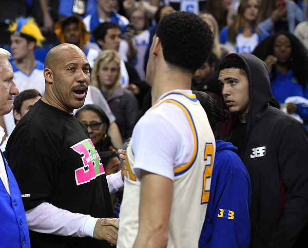 Lavar Ball, father of NBA draft prospect Lonzo Ball, congratulates his son after a game at UCLA. (Associated Press photo).