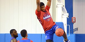 Red Team guard Malik Newman finishes a slam dunk during a camp scrimmage on Wednesday, June 14, 2017 at the Horejsi Family Athletics Center.