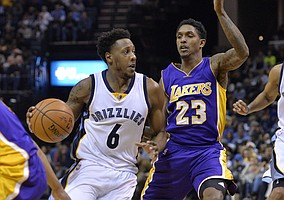 Memphis Grizzlies guard Mario Chalmers (6) controls the ball against Los Angeles Lakers guard Louis Williams (23) during the second half of an NBA basketball game Wednesday, Feb. 24, 2016, in Memphis, Tenn. (AP Photo/Brandon Dill)