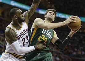 Utah Jazz's Jeff Withey (24) drives against Cleveland Cavaliers' LeBron James (23) in the first half of an NBA basketball game, Thursday, March 16, 2017, in Cleveland. (AP Photo/Tony Dejak)