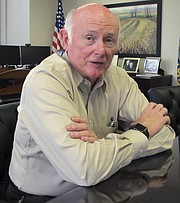In this June 28, 2017 photo, Kansas Revenue Secretary Sam Williams answers questions about tax issues during an interview in his Topeka office.