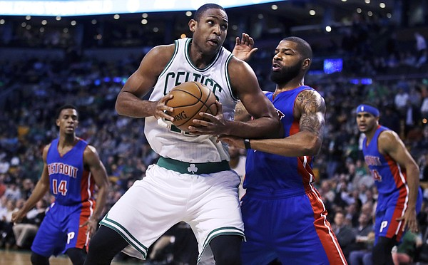 Thanks to reports of a Friday trade, Marcus Morris seems poised to be going from defending players like Al Horford (pictured) to playing alongside him in Boston. (AP Photo)