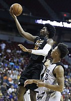 Phoenix Suns' Josh Jackson shoots in front of Sacramento Kings' Malachi Richardson, right, during the second half of an NBA summer league basketball game, Friday, July 7, 2017, in Las Vegas. (AP Photo/John Locher)