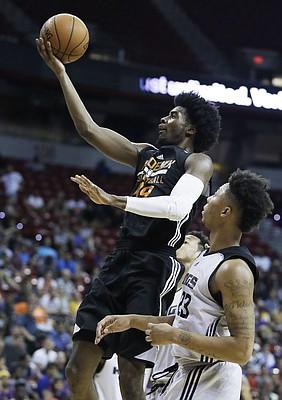 Phoenix Suns' Josh Jackson shoots in front of Sacramento Kings' Malachi Richardson, right, during the second half of an NBA summer league basketball game, Friday, July 7, 2017, in Las Vegas. (AP Photo/John Locher)