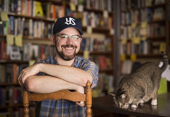 Danny Caine is set to take over as owner of the Raven Bookstore on August 1 after purchasing the business from current owner Heidi Raak. Caine is happy to announce that the store cats will also be staying.