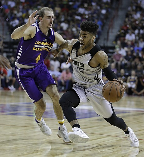Sacramento Kings' Frank Mason III drives around Los Angeles Lakers' Alex Caruso during the first half of an NBA summer league basketball game, Monday, July 10, 2017, in Las Vegas. (AP Photo/John Locher)