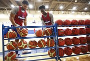 Kansas forward Dedric Lawson, left, and guard Marcus Garrett grab a couple of European basketballs during an open practice on Tuesday, July 11, 2017. The Jayhawks are preparing for four exhibition games in Italy in early August.