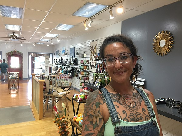 Nicole Manriquez is the manager and buyer for the Striped Cow, a new shop in Downtown Lawrence.