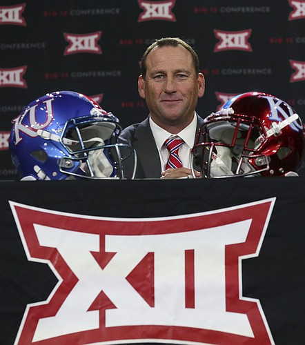 Kansas head coach David Beaty takes his seat before speaking to reporters during the Big 12 NCAA college football media day in Frisco, Texas, Monday, July 17, 2017. (AP Photo/LM Otero)