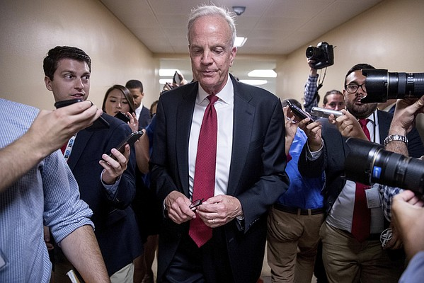 Sen. Jerry Moran, R-Kan. speaks to reporters as he arrives on Capitol Hill in Washington, Tuesday, July 18, 2017. (AP Photo/Andrew Harnik)