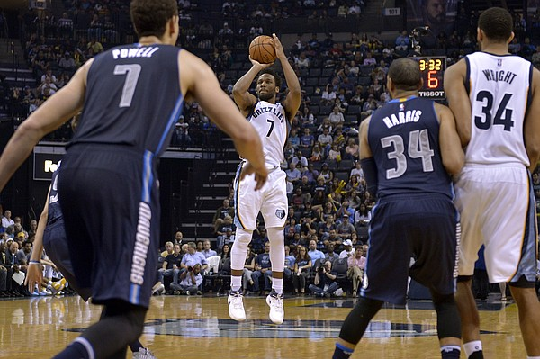 Memphis Grizzlies guard Wayne Selden, center, attempts a 3-point shot as Dallas Mavericks forward Dwight Powell, from left, guard Devin Harris, and Grizzlies forward Brandan Wright look on in the second half of an NBA basketball game Wednesday, April 12, 2017, in Memphis, Tenn. (AP Photo/Brandon Dill)