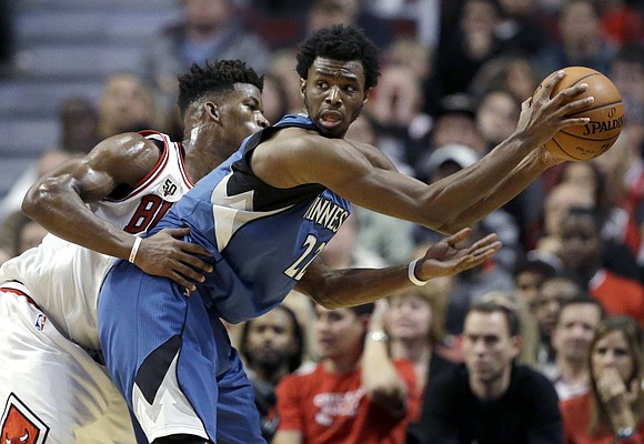 FILE — Minnesota Timberwolves guard/forward Andrew Wiggins, right, looks to a pass as Chicago Bulls guard/forward Jimmy Butler guards during overtime of an NBA basketball game on Saturday, Nov. 7, 2015, in Chicago. The Timberwolves acquired Butler via trade this summer and now the two are teammates. (AP Photo/Nam Y. Huh)