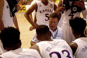 Kansas head coach Bill Self, center, gives suggestions to his players during a pause of a basketball game against HSC Roma in Rome, Wednesday, Aug. 2, 2017. (AP Photo/Riccardo De Luca)