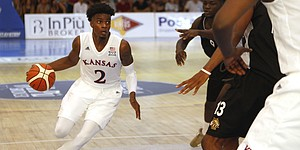 Kansas junior Lagerald Vick, left, in action during a basketball game against HSC Roma in Rome, Wednesday, Aug. 2, 2017. (AP Photo/Riccardo De Luca)