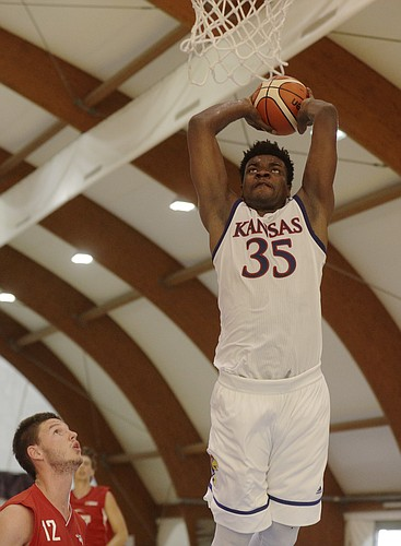 Kansas University's Udoka Azubuike goes for a slam dunk during a basketball game in Rome, Thursday, Aug. 3, 2017.
