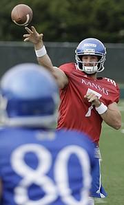 Kansas junior quarterback Peyton Bender unleashes a pass during a preseason practice on Monday, Aug. 7, 2017.