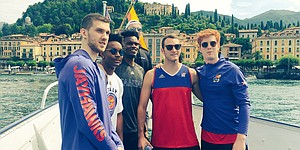 Kansas players, from left, Svi Mykhailiuk, Devonte' Graham, Lagerald Vick, Mitch Lightfoot, Clay Young and Chris Teahan huddle up for a group shot as the Jayhawks' boat approaches Bellagio from Lake Como on Monday, Aug. 7, 2017.
