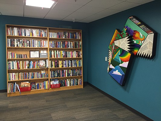 Books are on display at DownHall Books in the basement level of the Lawrence Public Library. The mini-store is near the library's business center.