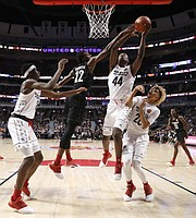 "Big East's Mitchell Robinson (22) blocks the shot of Big West's Brandon L. McCoy (44) as Jaren Jackson Jr., left, and Brian ""Tugs"" Bowen II, watch during the second half of the McDonald's All-American boys basketball game Wednesday, March 29, 2017, in Chicago. The West team won 109-107. (AP Photo/Nam Y. Huh)"