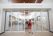 A media member on a tour of Downs Hall looks into the South Dining Commons which adjoins Downs with Oliver Hall, Friday, Aug. 11, 2017.