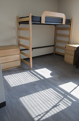 The rooms in Downs Hall come equipped with loft-style beds, which make room for storage below, but which can also be adjusted to sit lower to the ground.