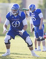 Kansas offensive lineman Mesa Ribordy moves to block a defender during practice on Friday, Aug. 11, 2017 at the practice fields west of Hoglund Ballpark.