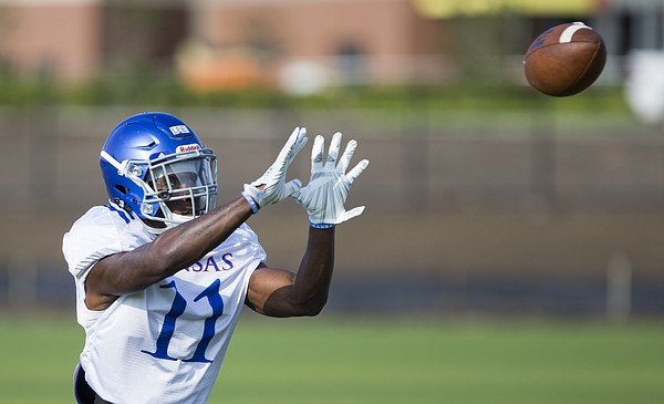 Kansas safety Mike Lee makes a catch during practice on Friday, Aug. 11, 2017 at the practice fields west of Hoglund Ballpark.