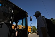 A Lawrence transit rider boards a bus on Thursday, Aug. 17, 2017 at the downtown bus hub at Seventh and Vermont streets.
