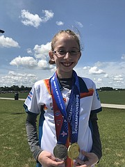 Adriana Cain, a Chicago resident and sixth-grader at Lawrence Virtual School, earned first- and second-place scores at the U.S.A. Archery Outdoor National Championships earlier this month in suburban Indianapolis. In this photo, Cain shows off her medals at the competition.