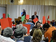 Audience members hold up red and green cards, showing they either agree or disagree, during a town hall meeting with Republican U.S. Sen. Jerry Moran of Kansas Friday at an American Legion hall in Topeka.