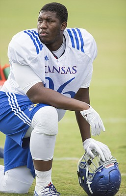 Kansas defensive tackle Daniel Wise catches a break during practice on Friday, Aug. 18, 2017 at the grass fields adjacent to Hoglund Ballpark.