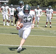 Free State running back Jax Dineen (33) punches it in for a score from one yard out during the Firebirds' scrimmage on Saturday at FSHS.
