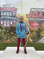 Adriana Cain, a Chicago resident and sixth-grader at Lawrence Virtual School, earned first- and second-place scores at the U.S.A. Archery Outdoor National Championships in August 2017 in Indianapolis. She is shown here with her bow.