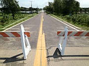 Country Route 458 north of Vinland was closed Tuesday because of flooding.