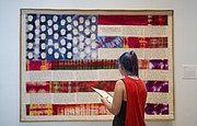 "Free State junior Makayla Zolman studies Faith Ringgold&squot;s ""Flag Story Quilt"" during a tour of the Spencer Museum of Art on Tuesday, Aug. 22, 2017."