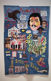 "A quilt by Lawrence artist Marla Jackson, ""Still We Rise,"" which depicts the events of and surrounding William Clarke Quantrill&squot;s raid of Lawrence on Aug. 21, 1863, was completed along with eight high school students, whom Jackson mentored through the process."