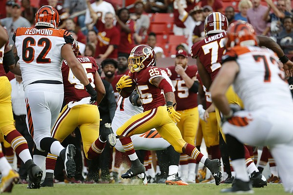 Washington Redskins defensive back Fish Smithson (25) rushes the ball after intercepting a pass attempt by Cincinnati Bengals quarterback AJ McCarron in the second half of a preseason NFL football game, Sunday, Aug. 27, 2017, in Landover, Md. (AP Photo/Alex Brandon)