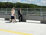 Lt. Gov. Jeff Colyer, right, who is primed to take over as governor in a matter of weeks, walks across a new rural bridge over the Kansas River west of Topeka with his spokeswoman Kara Fullmer and special assistant Clay Barker. Colyer helped dedicate the new bridge Monday while carefully avoiding any questions about state policy.