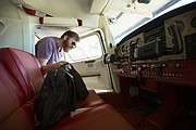 Austin Pyle, of Mission, removes his things from inside a plane after flying on Tuesday, Aug. 29, 2017 at the Vinland Valley Aerodrome.