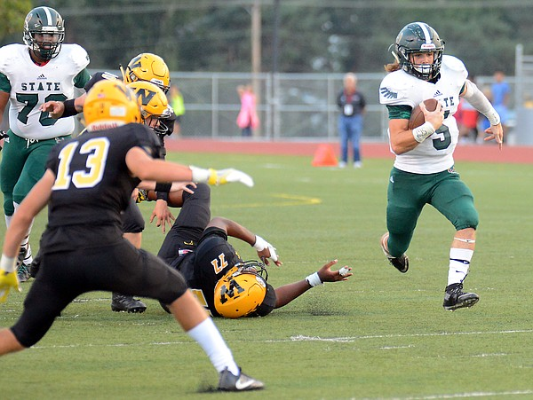 Gage Foster, of Free State, got some open space for yards against Shawnee Mission West during the first quarter on Friday, Sept. 1, 2017 at Shawnee Mission South District Stadium.