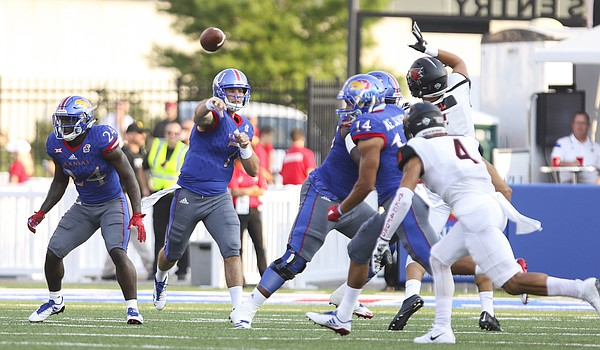 Kansas quarterback Peyton Bender (7) throws a touchdown pass to wide receiver Steven Sims Jr. (11) during the first quarter on Saturday, Sept. 2, 2017 at Memorial Stadium.